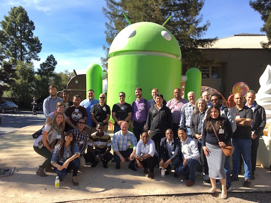 Exchange attendees group photo with Android statue