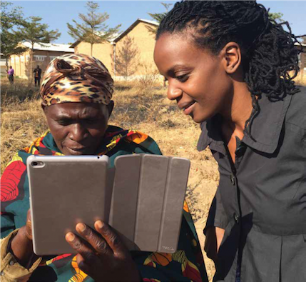 Photo of Catherine Nakalembe and Village Knowledge Extension Agent working with an electronic tablet