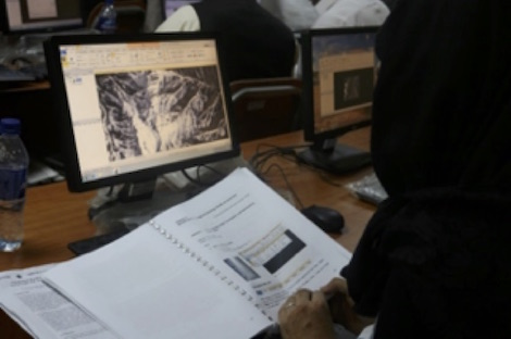 Students using computer and manual for GIS and RS applications to analyze information
