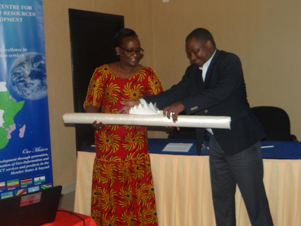 Emmanuel Nkurinziza hands LC maps to Mukarubibi Fatina
